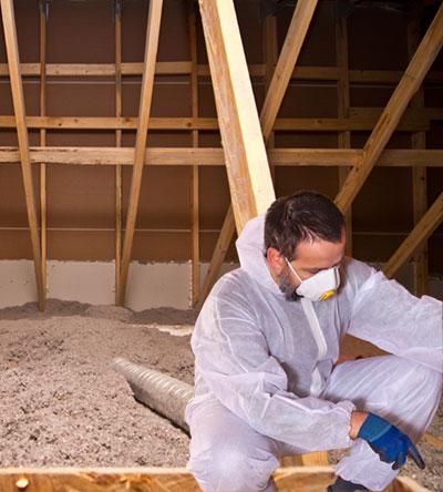 Insulation Contractor Inspecting Cellulose Insulation in Attic Fiberlite